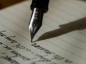 A pen writing